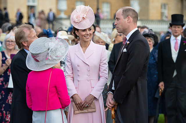 Kate Middleton and Prince William at a party in the garden of Buckingham Palace