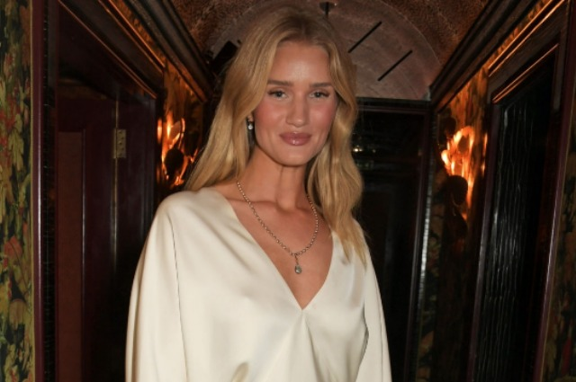 Rosie Huntington-Whiteley in cream mini at a party in London