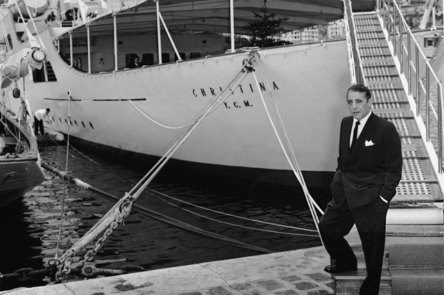 Aristotle Onassis next to his yacht Christina O