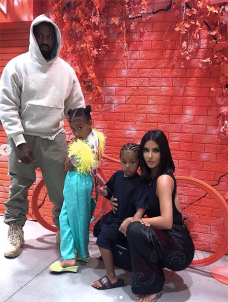Kanye West and Kim Kardashian with children