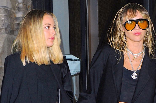 Don't Spill Water: Miley Cyrus and Caitlin Carter for a walk in New York
