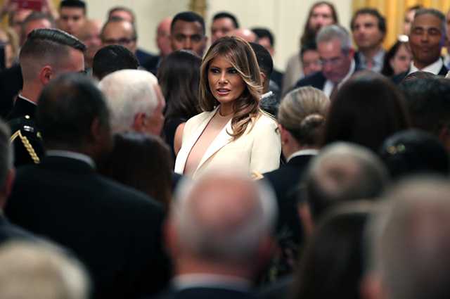 Melania Trump in a cream suit at a ceremony in the White House