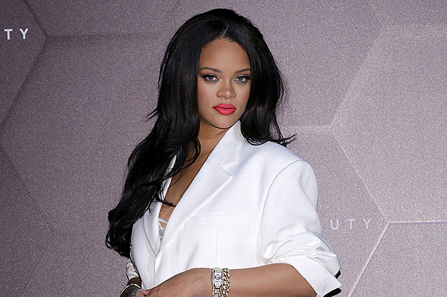 Rihanna in a white pantsuit attended a workshop of her brand Fenty in Seoul