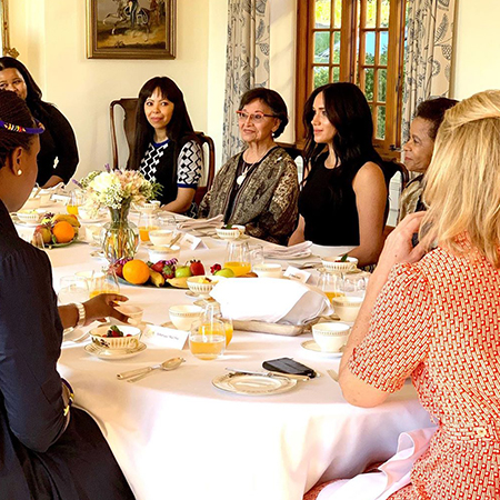 Meghan Markle with participants in a private breakfast