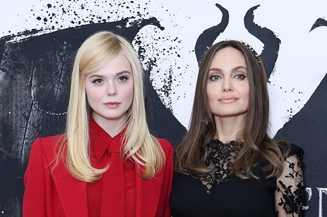 Angelina Jolie in the image of Maleficent and El Fanning at the London photocall