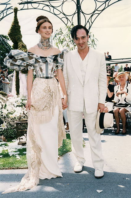 John Galliano with a model in the show finale