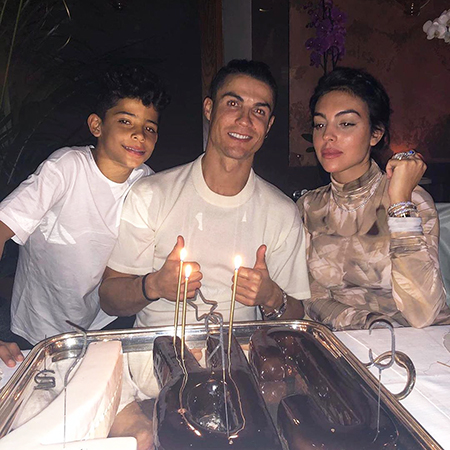 Cristiano Ronaldo with his son Cristiano Jr. and Georgina Rodriguez
