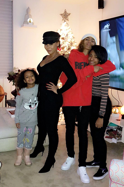Mel Bee with daughters Madison, Phoenix and Angel
