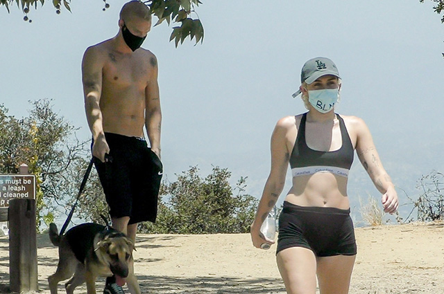 Miley Cyrus with sweetheart Cody Simpson on a walk in Los Angeles