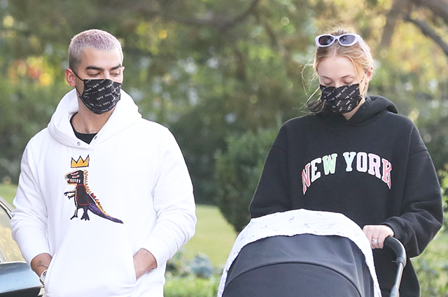 Sophie Turner and Joe Jonas take a walk with their two-month-old daughter in Los Angeles