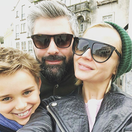 Dmitry Iskhakov and Polina Gagarina with their son Peter
