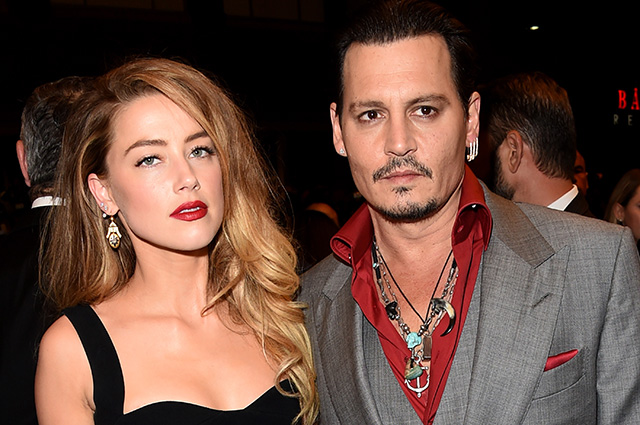 Amber Heard responded to Johnny Depp fans who accuse her of abuse and extortion